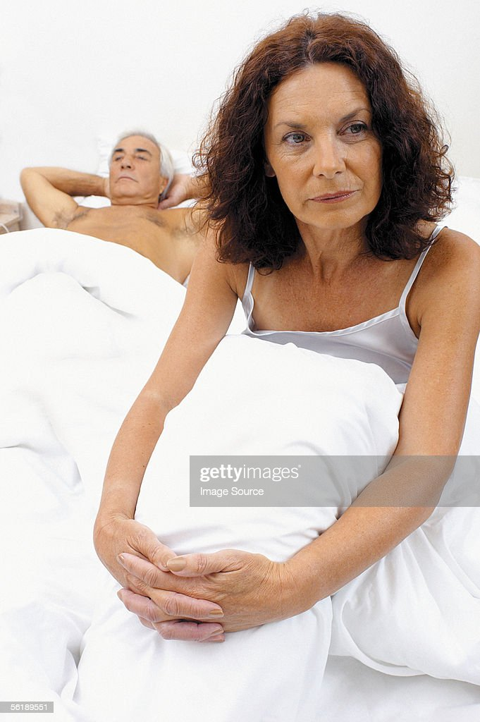 Woman in bed : Stock Photo