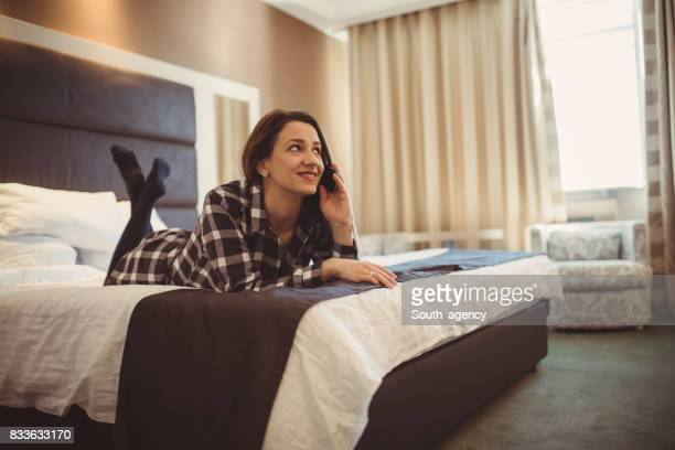 Woman in bed using phone