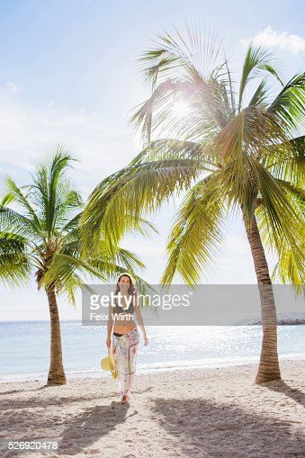 Woman in bikini relaxing on beach : Bildbanksbilder