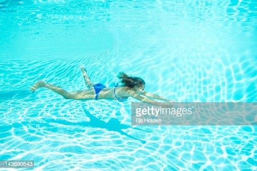 Woman In Bikini Swimming In Pool Stock Photo Getty Images