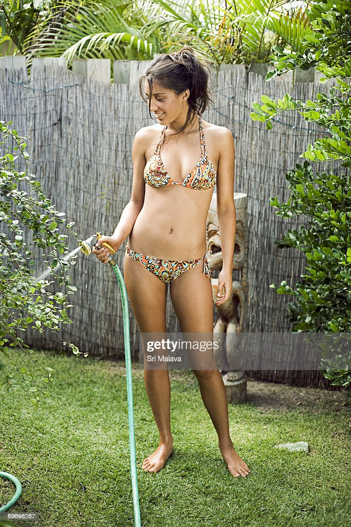 woman in bikini with hose stock photo getty images. Black Bedroom Furniture Sets. Home Design Ideas