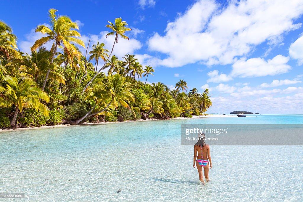 Woman in bikini with snorkel gear in a blue lagoon
