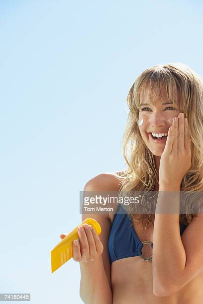 Woman in bikini with sun block