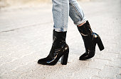Woman in black boots outdoor