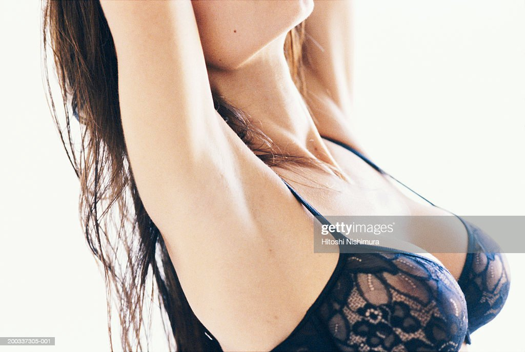 Woman in black bra, mid section, close-up : Stock Photo