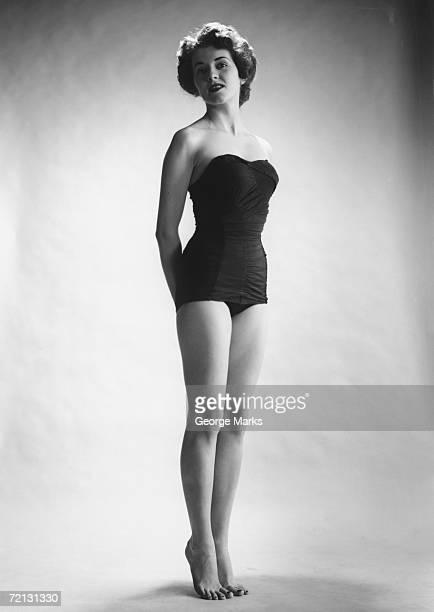 Woman in black corset posing in studio (B&W)