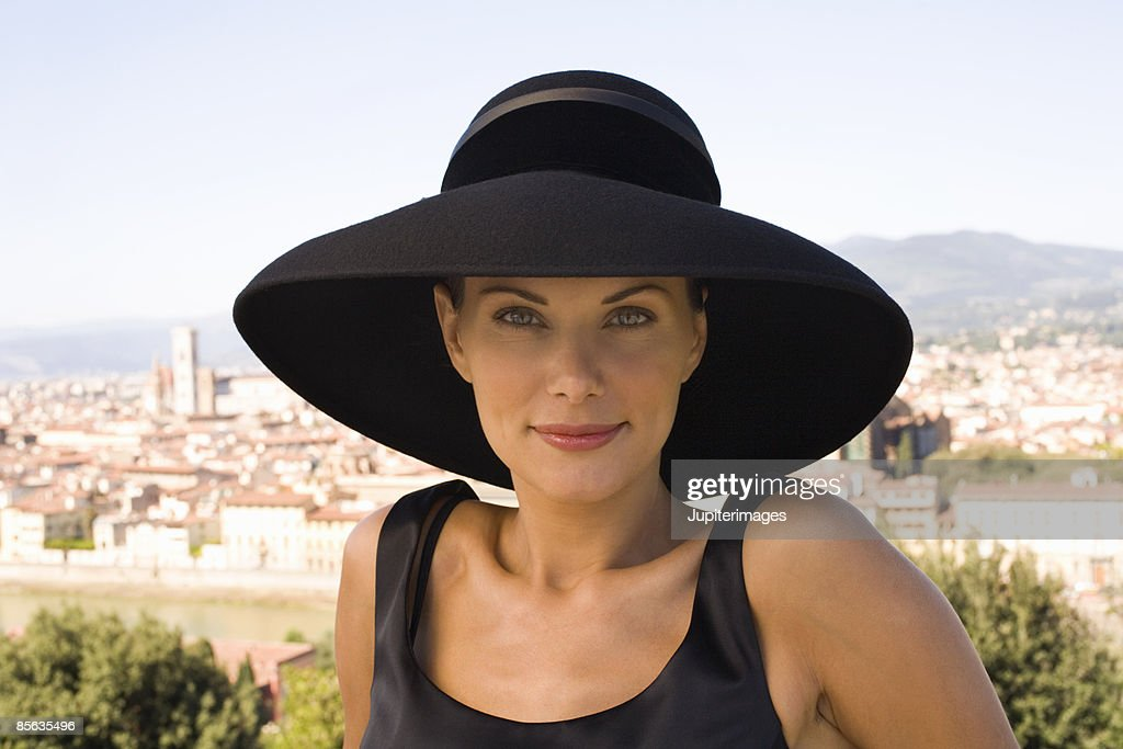 Woman in black hat, Florence, Italy
