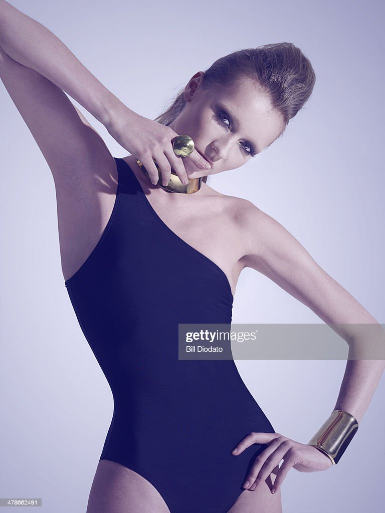 Woman in black swimsuit and jewelry : Stock Photo