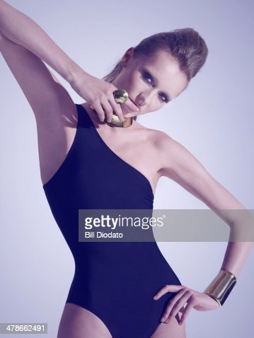 Woman in black swimsuit and jewelry