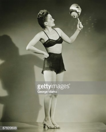 holding a mirror. woman in black underwear holding hand mirror studio stock photo | getty images a s