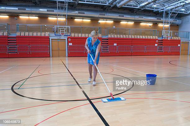 Woman in Blue Cleaning Floor