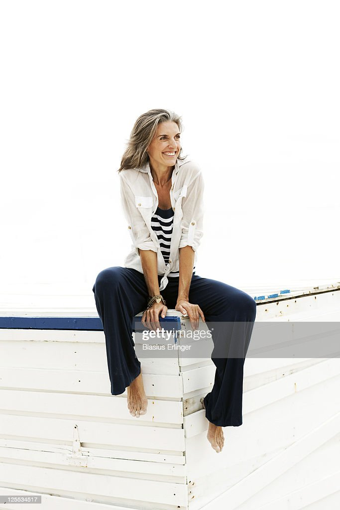 Woman In Blue Pants Looking Off : Stock Photo