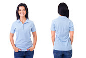 Young woman in blue polo shirt on white background