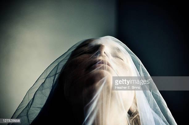 woman in blue veil