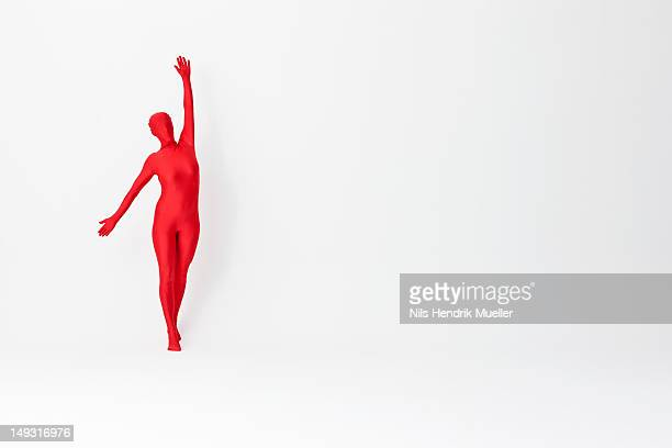 Woman in bodysuit posing