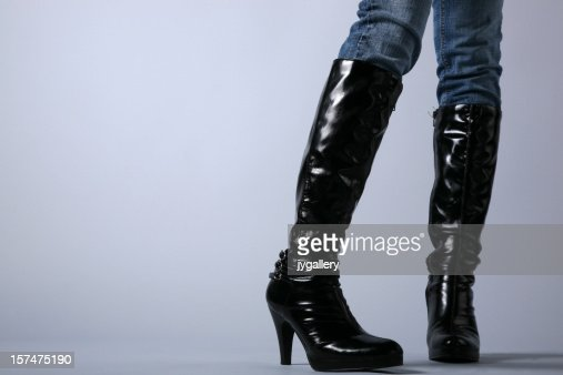 woman in boots on grey