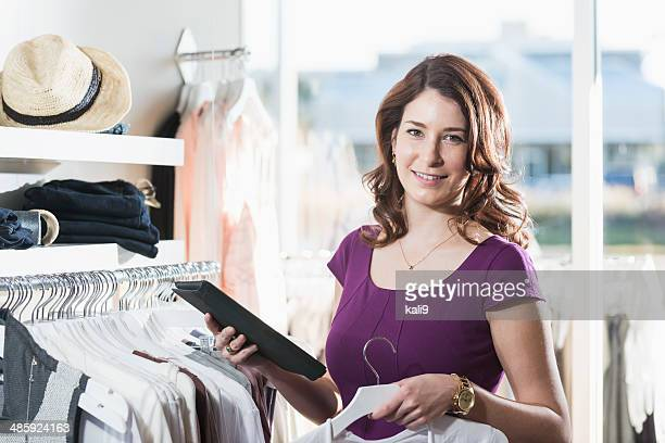 Woman in boutique with digital tablet