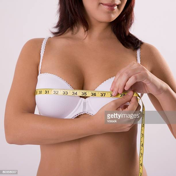 Woman in bra measuring bust line