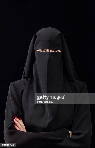 Woman in burka arms folded