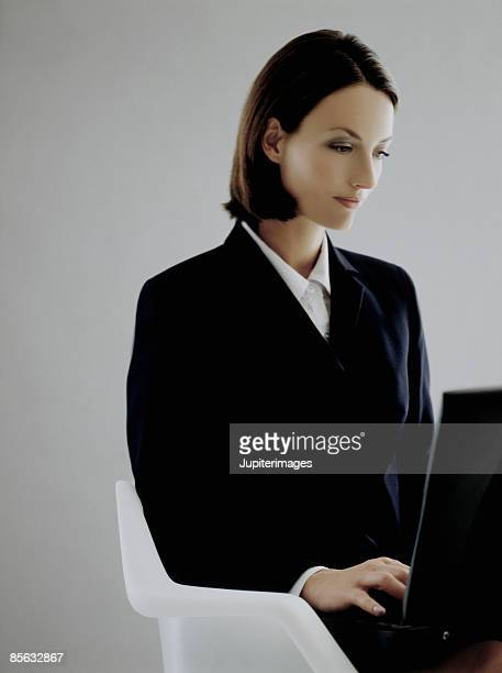 Woman in Business Attire Using Laptop Computer