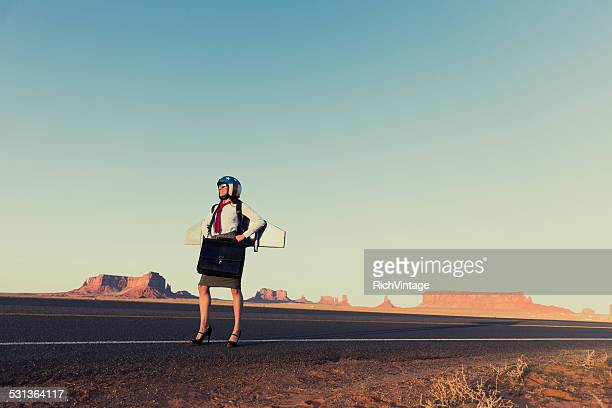 Woman in Business Attire wearing Jetpack in Monument Valley