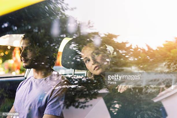 Woman in cab looking out reflected window
