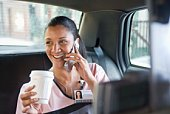 Woman in cab talking on cell phone
