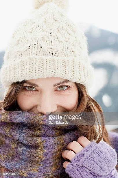 Woman in cap, scarf and gloves
