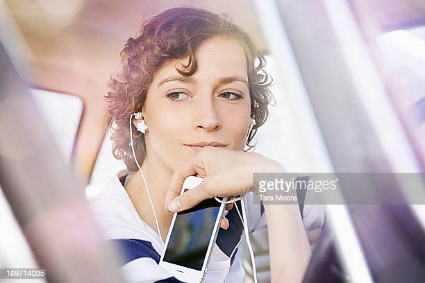 woman in car listening to music with mobile