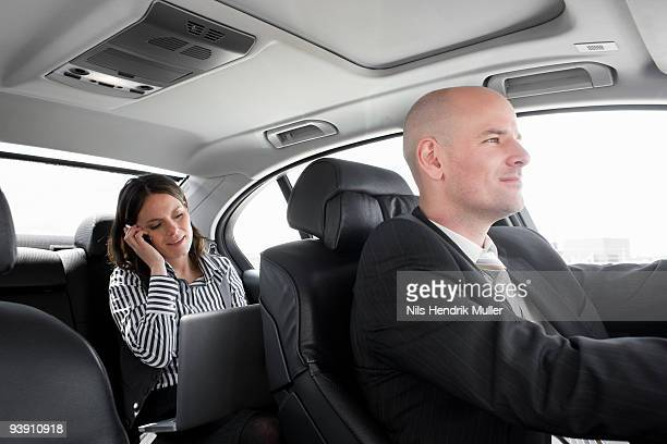 woman in car on phone with driver