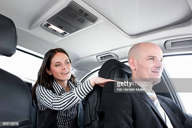 woman in car talking to driver
