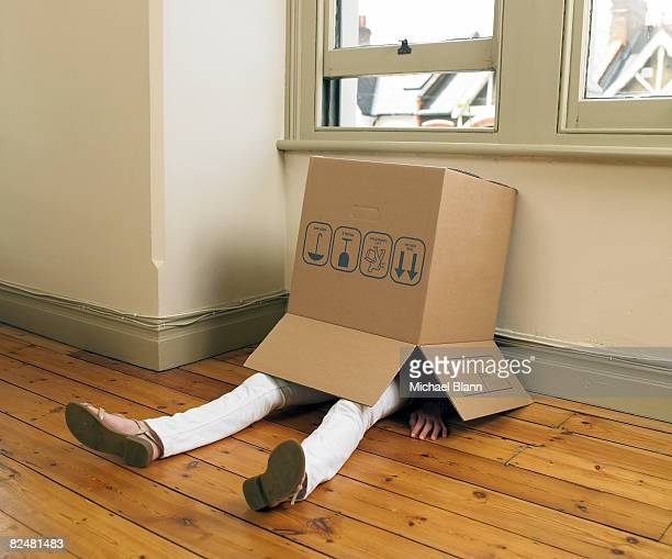 Woman in cardboard box