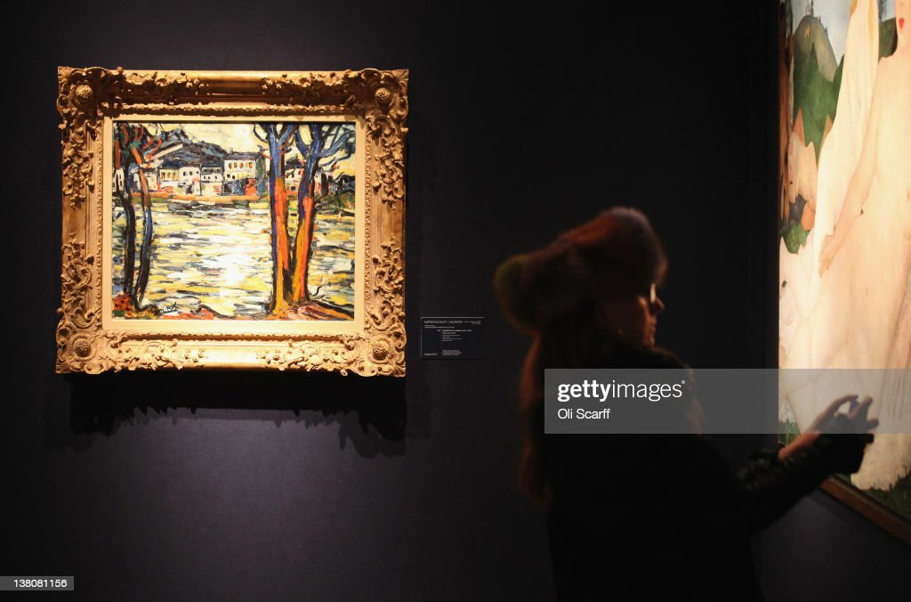A woman in Christie's auction house takes a photograph of a painting on February 2, 2012 in London, England. The artwork is being auctioned in Christie's forthcoming evening sales of 'Impressionist and Modern Art' and 'Art of the Surreal' which will take place between February 7, 2012 and February 9, 2012.