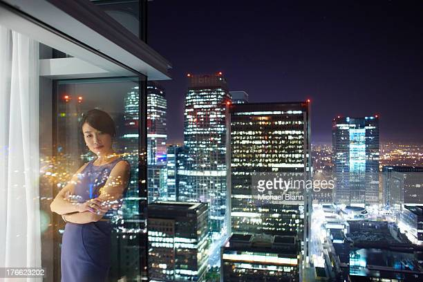 Woman in City apartment at night