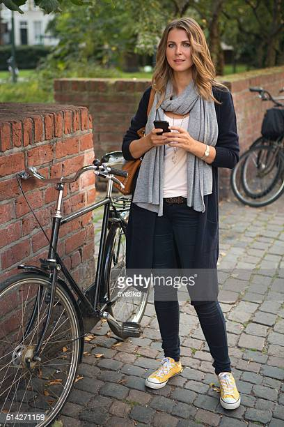 Woman in city using smart phone.