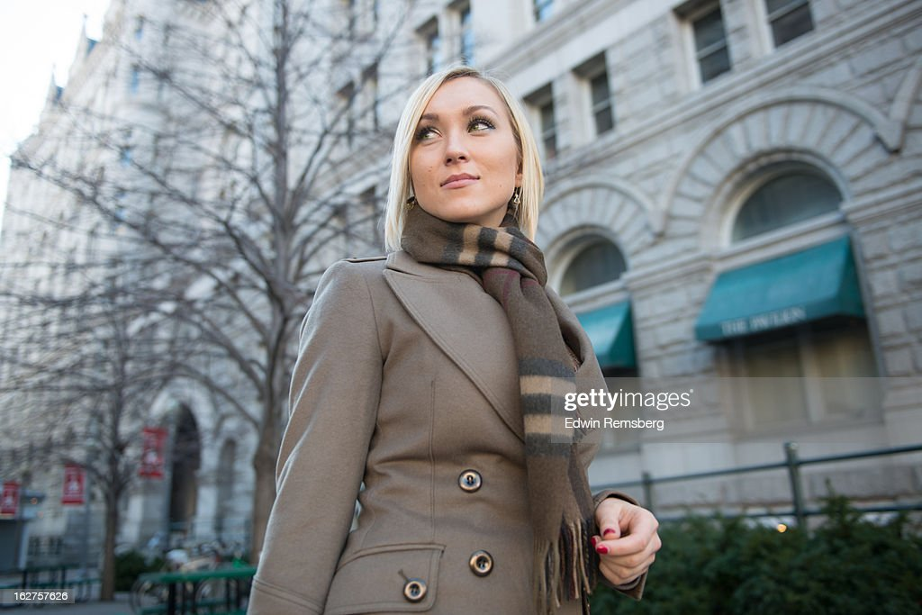 Woman in coat and scarf, walking. : Stock Photo