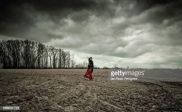 Woman in cold, barren field