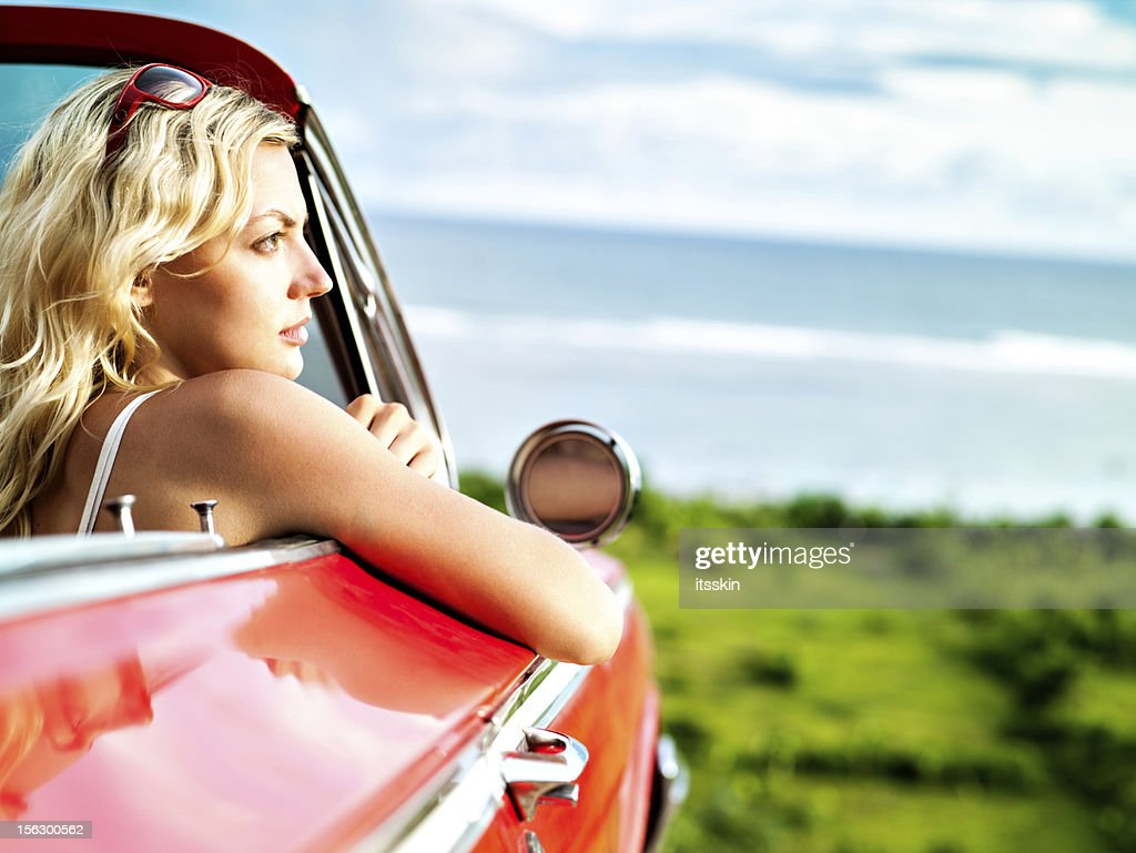 Woman in convertible car : Stock Photo