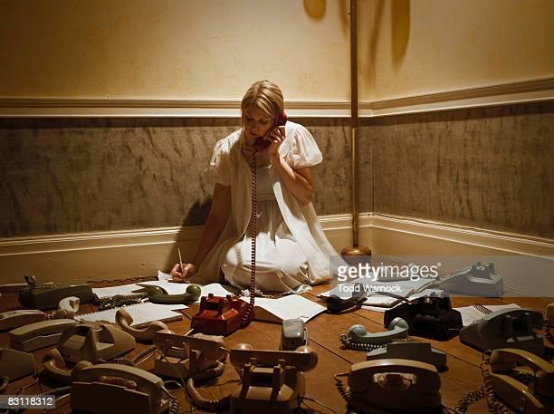 woman in corner answering phones
