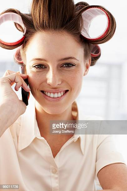 Woman in curlers talking on cell phone