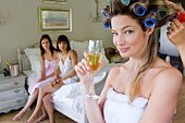 Woman in curlers with champagne