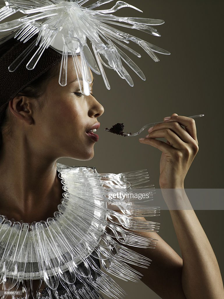 Woman in Cutlery Necklace and Headgear : Stock Photo