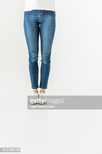 woman in denim pants and shoes standing isolated on white : Stock Photo