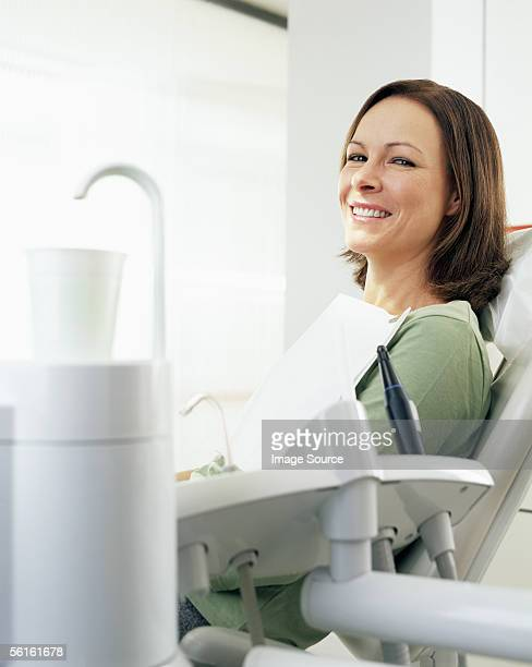 Woman in dentist's chair smiling