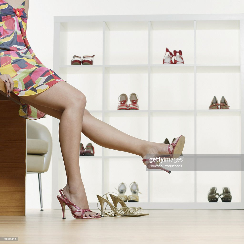 Woman in department store trying on shoes