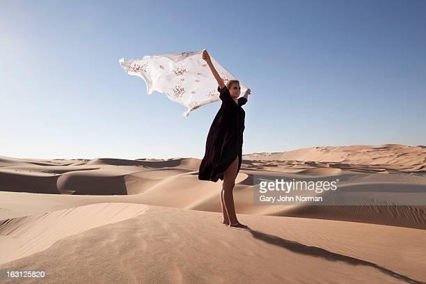 Woman in desert at Liwa Oasis, UAE