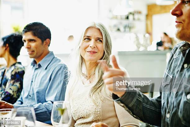 Woman in discussion with husband and friends