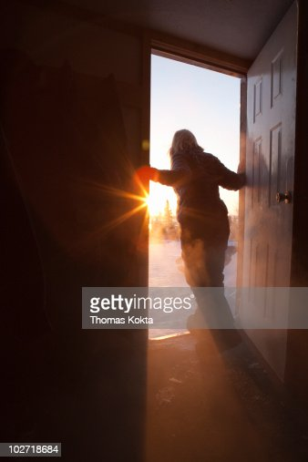 Woman in doorway looking outside