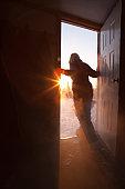 Woman in doorway looking outside