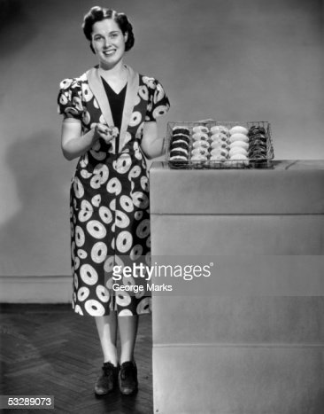 Woman in doughnut dress posing with past : Stock Photo